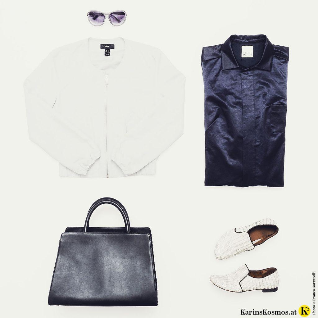 Produktfoto mit Overall, Sonnenbrille, Bomberjacke, Tasche und Halbschuhen.