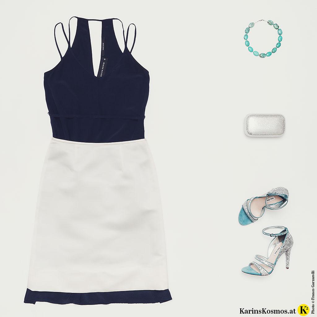 Produktfoto mit Slipdress, Satinrock in Weiß, Kette aus Türkisen, Clutch in Silber und Sandalen.