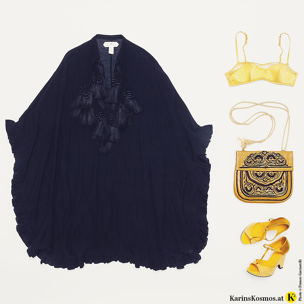 Produktfoto mit Kaftan für den Sommer, gelbem BH, Tasche und Sandalen.