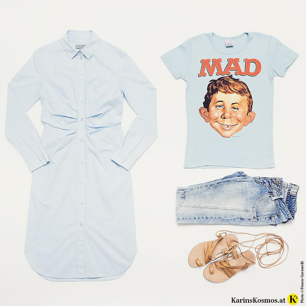 Produktstilllife mit Hemdblusenkleid, T-Shir mit Comic-Druck, Jeans und Ledersandalen aus Athen.